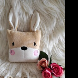 Bunny cuddle pillow.